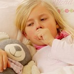 photolibrary_rm_photo_of_girl_coughing_in_bed1